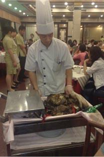 A Lou Wai Lou restaurant chef revealing the Prosperity Chicken!