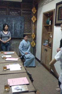Learning how to sit gracefully with teacher Hu