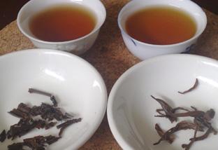 Lower grade Qimen Black tea (left) and the tender Royal Qimen Black.  The 'Golden Ring' in the Royal Qimen tea is more pronounced.'