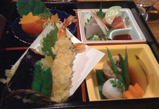 Arashiyama is like a bento box consisting of an assortment of appetizers, a seasonal simmered dish, chef's selection of raw fish, rice, and a choice of grilled fish or poultry of the day or tiger prawn tempura