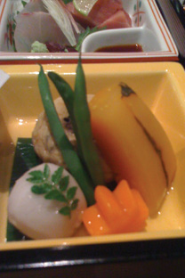 A seasonal simmered dish consisting of a minced mackerel ball, 'mud potato' (like a yam), simmered pumpkin and seasonal greens.  All the items are simmered separately so that they retain their individual tastes and flavours.