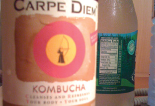 Carpe Diem Kombucha in a bottle is light.
