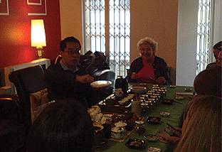 Demonstrating how one would pry open a Pu Erh tea cake