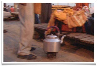 The Ganges lemon tea seller's ingenious portable kettle with stove attached.