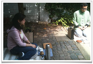 MedTEAtation ritual at Chaya Teahouse in the forecourt with our tea friend, Sam.