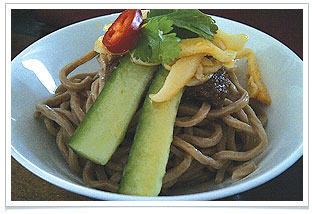 Oolong tea noodles with homemade hunan-style sauce at chaya teahouse.